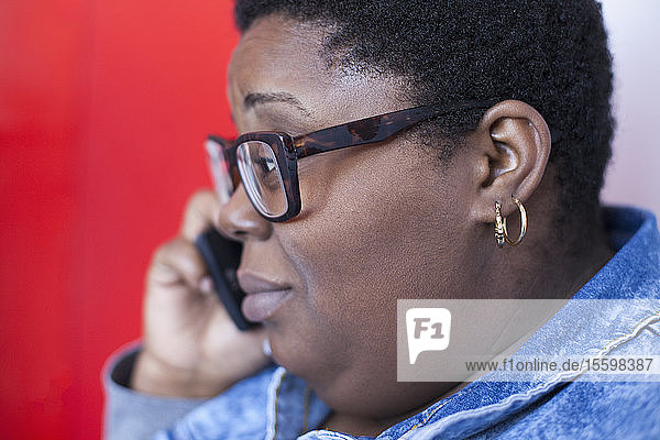Close-up of a woman with bipolar disorder talking on her cell phone