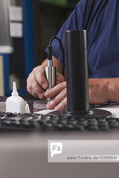 Engineer rebuilding an O2 electrochemical sensor probe in a laboratory