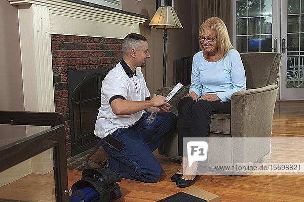 Cable installer showing home owner how to use the remote