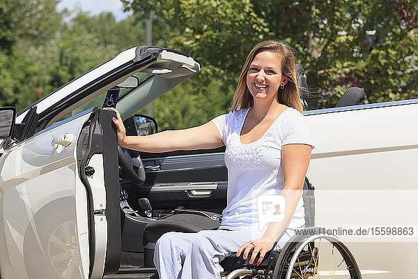 Woman with a spinal cord injury in her wheelchair and getting into her adaptive vehicle