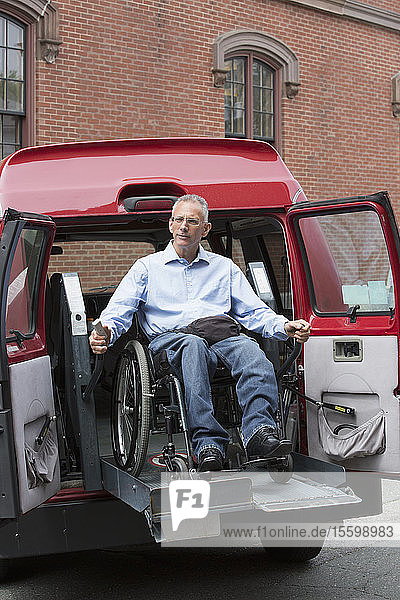 Man with a Spinal Cord Injury exiting an accessible van in a parking lot