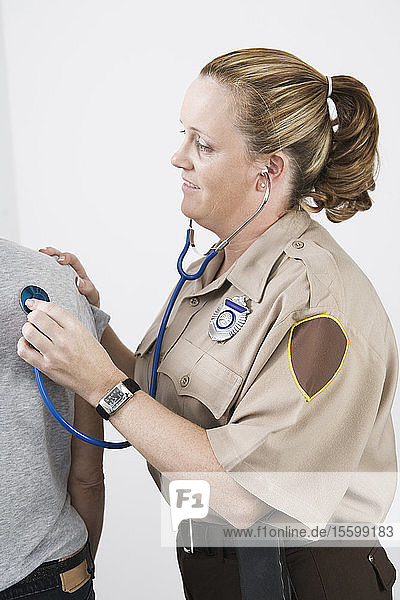 Emergency Medical Service officer checking pulse of a patient