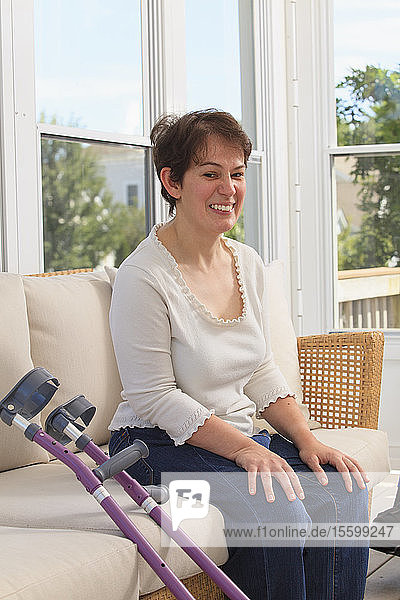 Woman with Cerebral Palsy and her crutches