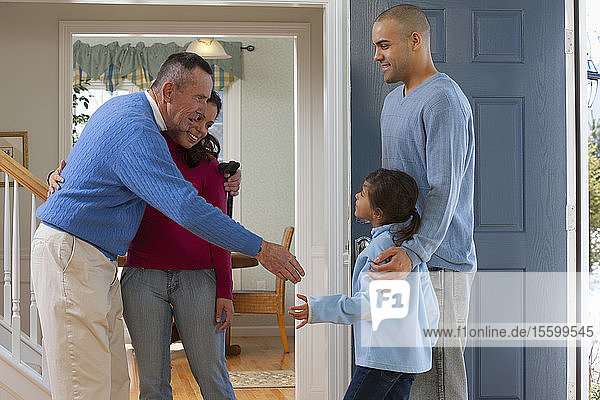 Man with Parkinson's welcoming his children and granddaughter