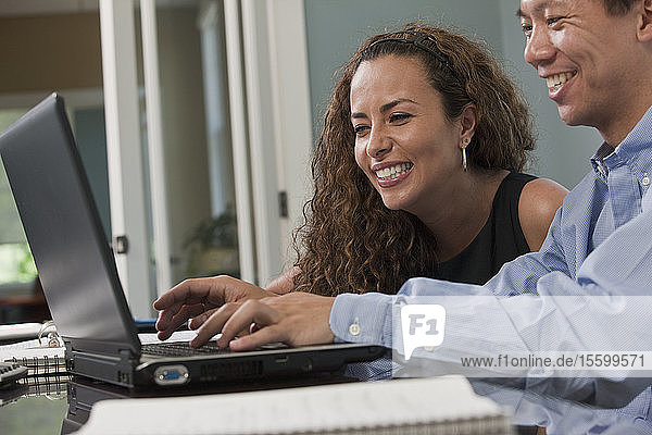 Visually impaired Hispanic businesswoman with her colleagues in an office