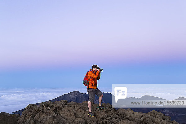 Tourist photographing on a mountain summit  Haleakala; Maui  Hawaii  United States of America