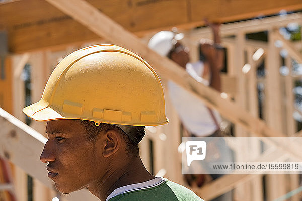Carpenters in a framed house