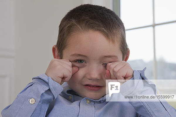 Boy signing the word 'Sleepy' in American Sign Language