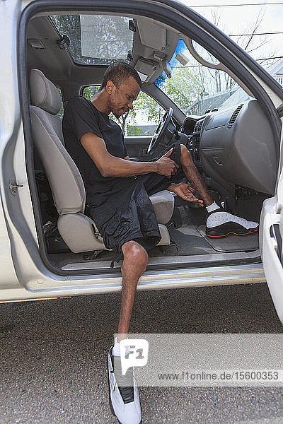 Man who had Spinal Meningitis getting into his accessible vehicle