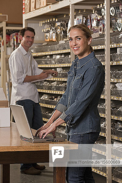 Supervisors putting away inventory in a hardware store