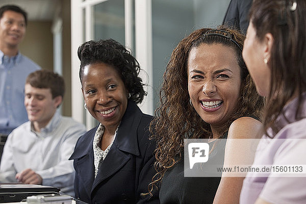 Visually impaired Hispanic businesswoman with her colleagues in a board room