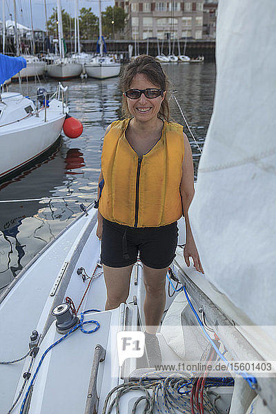 Woman who has visual impairment standing on a boat