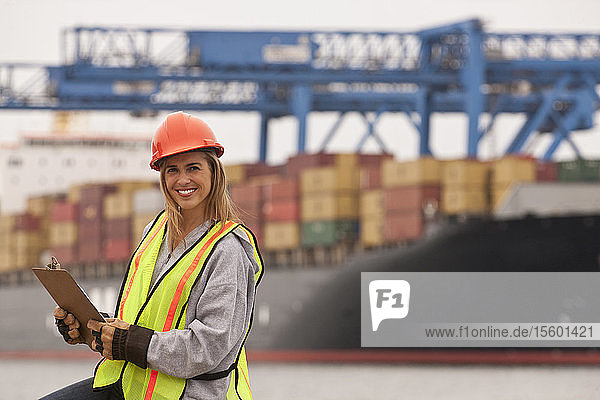 Female transportation engineer working on a commercial dock