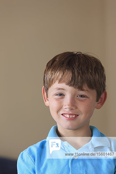 Portrait of a happy young boy with hearing impairment