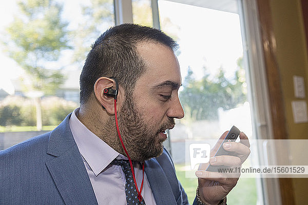 Businessman with Visual Impairment listening to his computer
