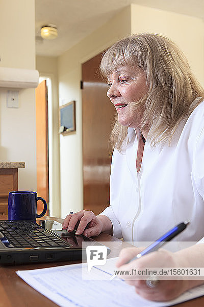 Woman with Bipolar disorder working from home on her laptop