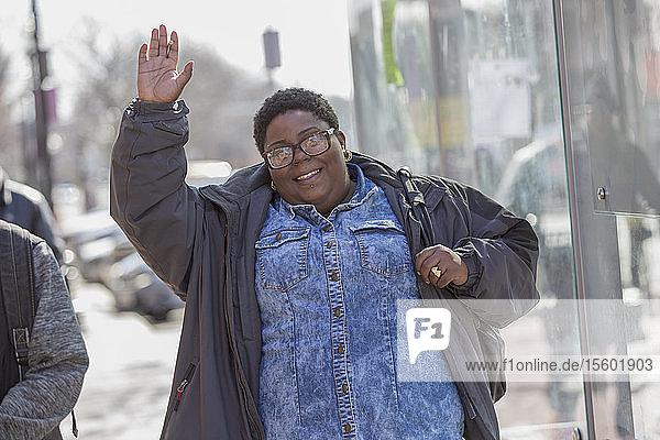 Happy woman with bipolar disorder walking in her neighborhood and smoking