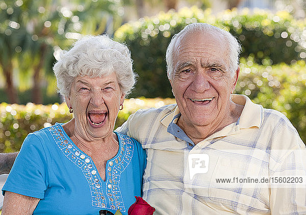 Senior couple smiling and laughing in a park