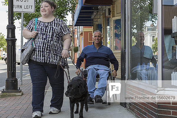 Man with Spinal Cord Injury and his daughter shopping with her service dog