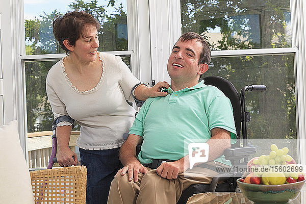 Couple with Cerebral Palsy sitting on their deck