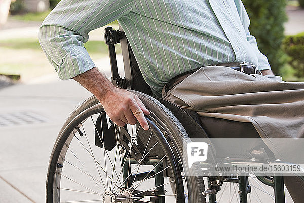 Man with a spinal cord injury sitting in a wheelchair
