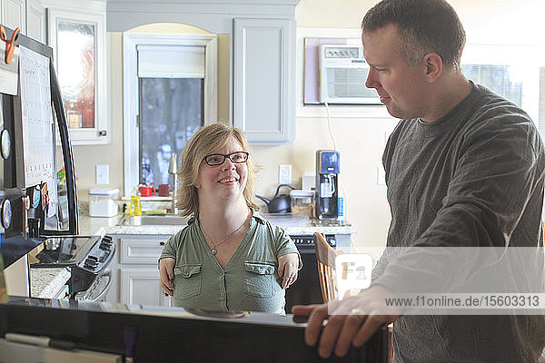 Woman with TAR Syndrome and her husband using their computer at home