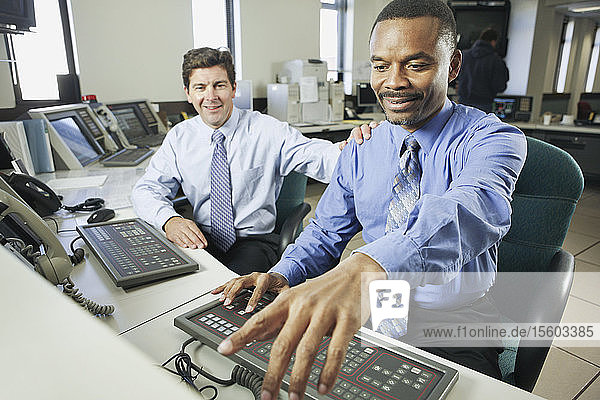 Two operating engineers working in a control room