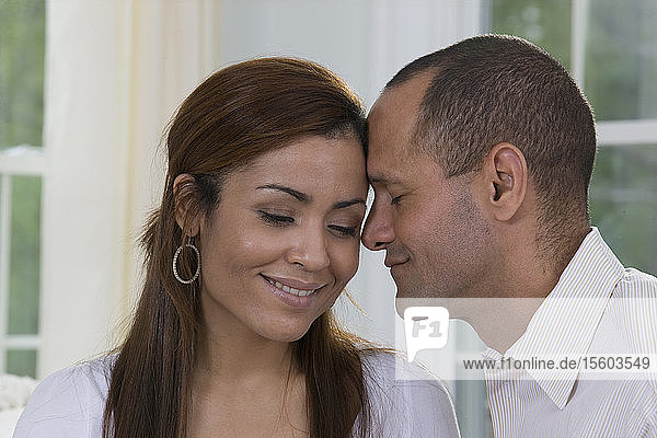 Close-up of a Hispanic couple romancing