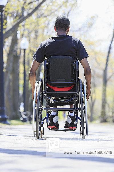 Man in a wheelchair who had Spinal Meningitis