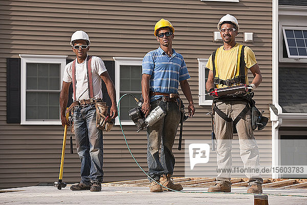 Carpenters working with construction tools