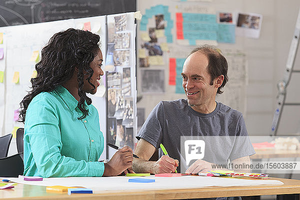 Engineering instructor with Aspergers demonstrating technical material with student in ideation lab