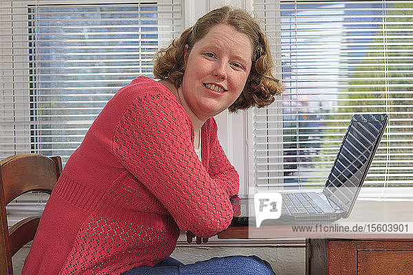 Young woman with Autism using her laptop