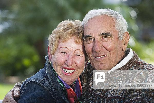 Portrait of a senior couple smiling.