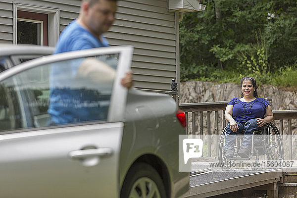 Woman with Spina Bifida and her husband getting ready to get in the car