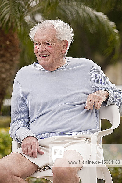 Man watching a game and smiling