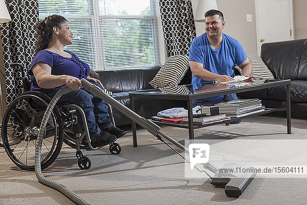 Woman with Spina Bifida and her husband cleaning their home