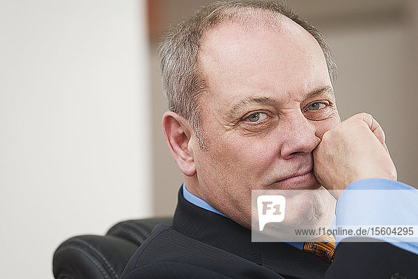 Portrait of a senior businessman thinking