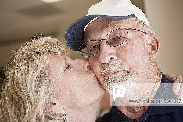 Close-up of a woman kissing a man