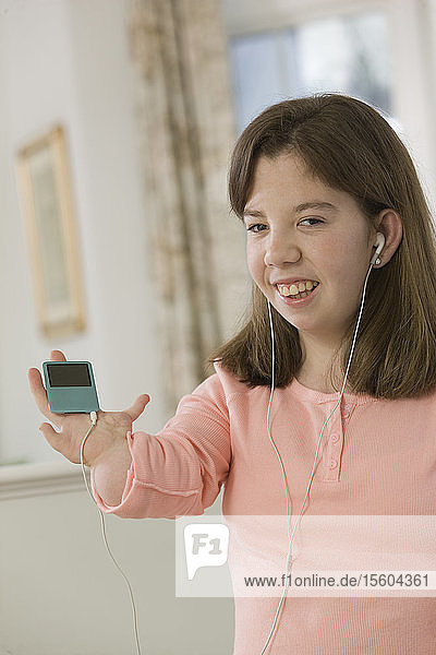 Teenage girl listening to an MP3 player in hand with birth defect