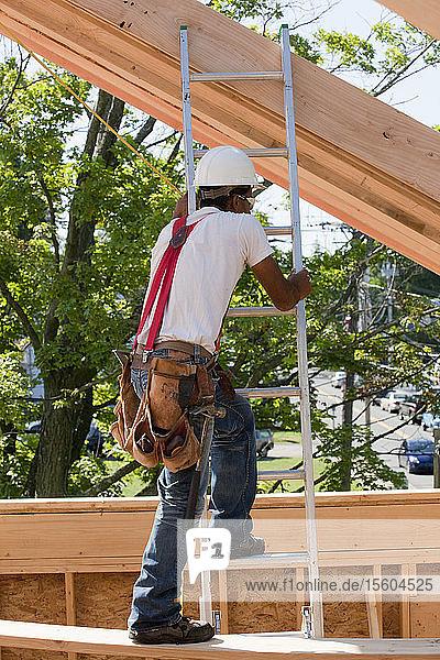 Carpenter climbing a ladder
