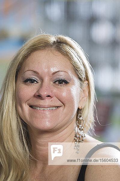 Portrait of a Brazilian woman smiling.