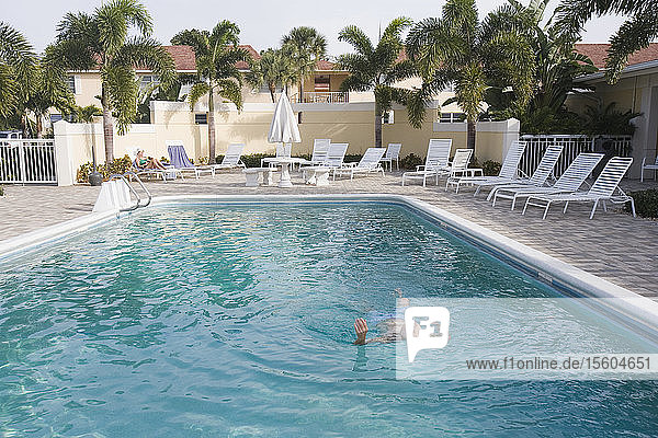 Senior man in a swimming pool  Florida  USA