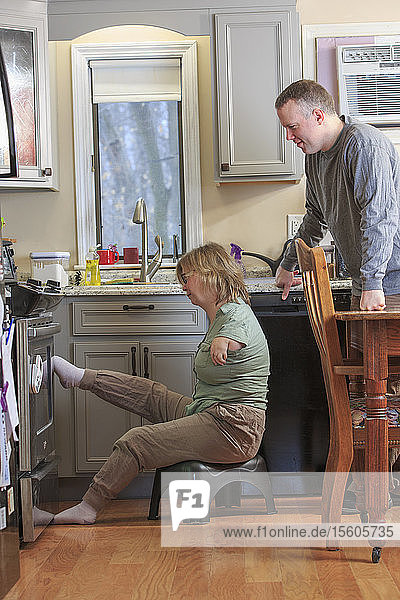 Woman with TAR Syndrome working with her husband in the kitchen