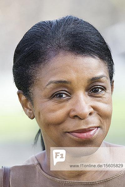 Portrait of a mature woman smiling.