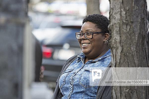 Happy woman with bipolar disorder walking in her neighborhood