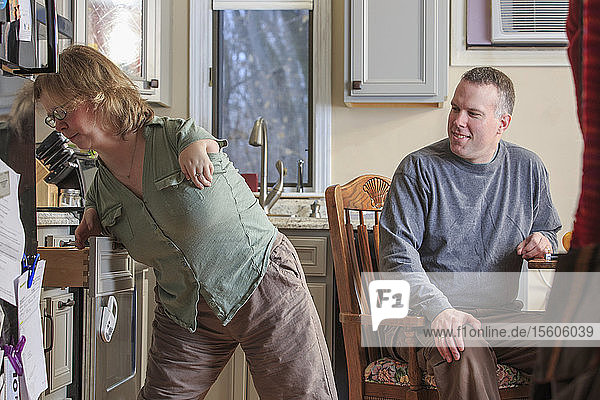 Woman with TAR Syndrome using a kitchen drawer with her husband