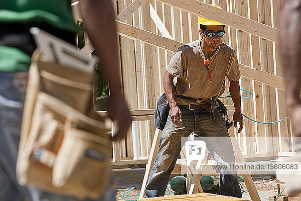 Carpenters working on a framed house