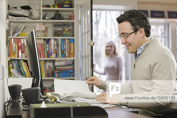 Hispanic businessman working in a home office