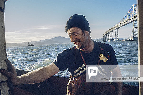A deckhand on a tugboat of the San Francisco Bay.
