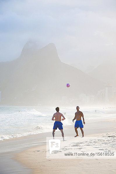 Two Men Playing Soccer In The Surf On Ipanema Beach  Rio De Janeiro  Brazil
